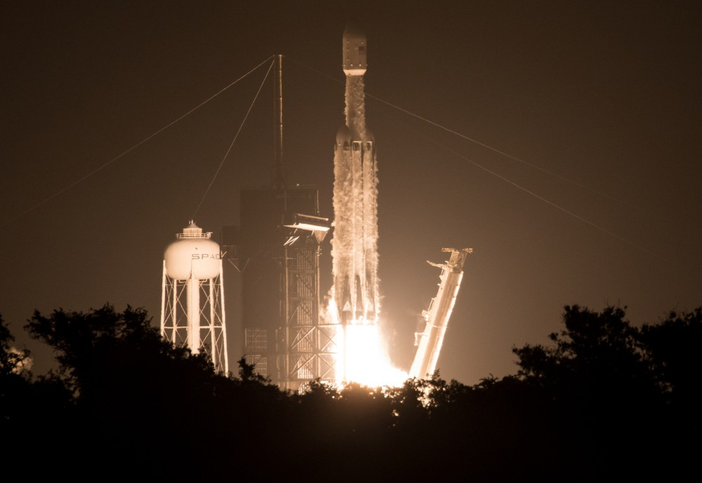 "A SpaceX Falcon Heavy rocket carrying 24 satellites as part of the Department of Defense's Space Test Program-2 (STP-2) mission launches from Launch Complex 39A, Tuesday, June 25, 2019 at NASA's Kennedy Space Center in Florida. Four NASA technology and science payloads which will study non-toxic spacecraft fuel, deep space navigation, ""bubbles"" in the electrically-charged layers of Earth's upper atmosphere, and radiation protection for satellites are among the two dozen satellites that will be put into orbit. Photo Credit: (NASA/Joel Kowsky)"